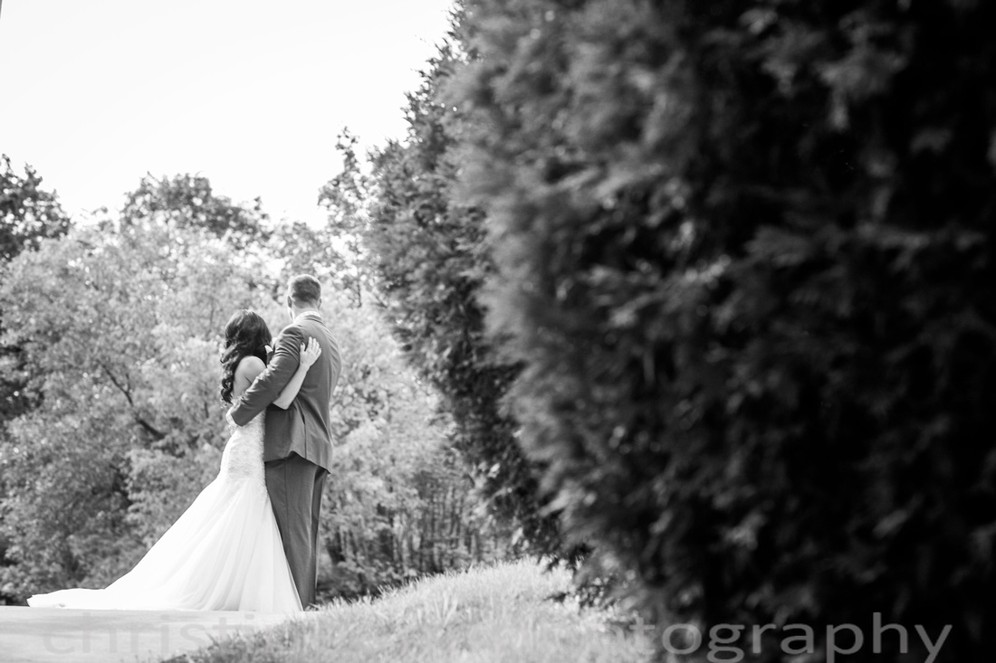 Candid photography bride and groom facing away from camera second shooting