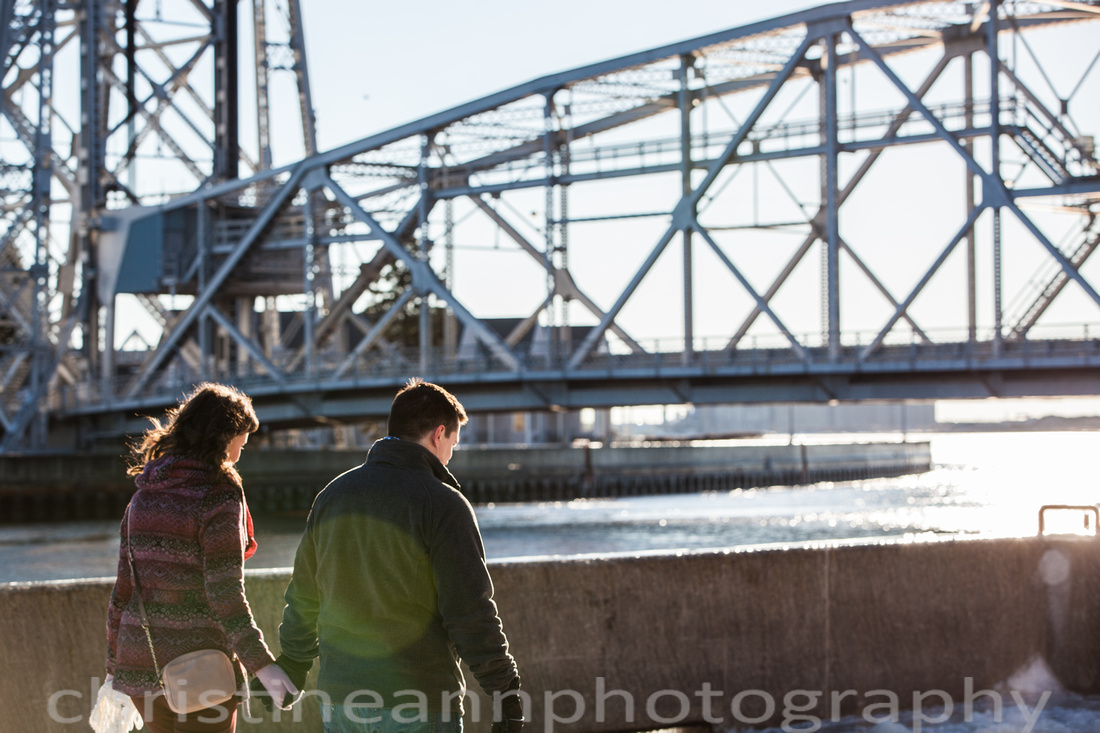 North Shore winter engagement photography session in Duluth Minnesota by Lake Superior with Aerial Lift Bridge and Light House