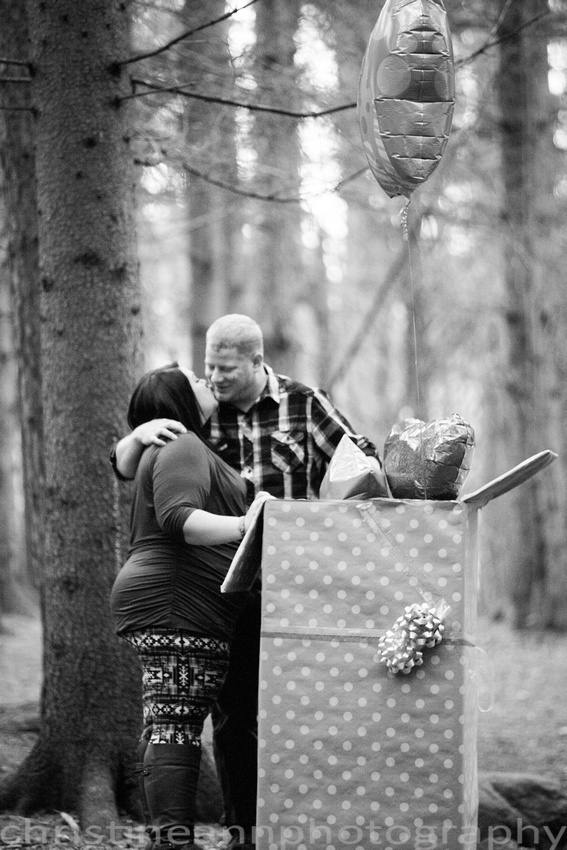 it's a girl gender sex couples reveal with balloons in a box in the forest duluth mn