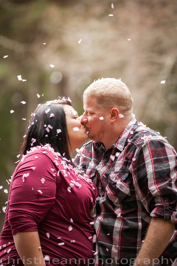 Couples maternity gender reveal with confetti hartley  nature center Duluth MN photographer married kiss