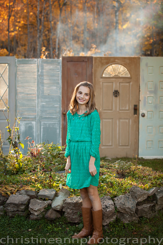 Children and family session in Hermantown MN at golden hour by doors in garden and in forest.  Family of five with three daughters in matching dresses.