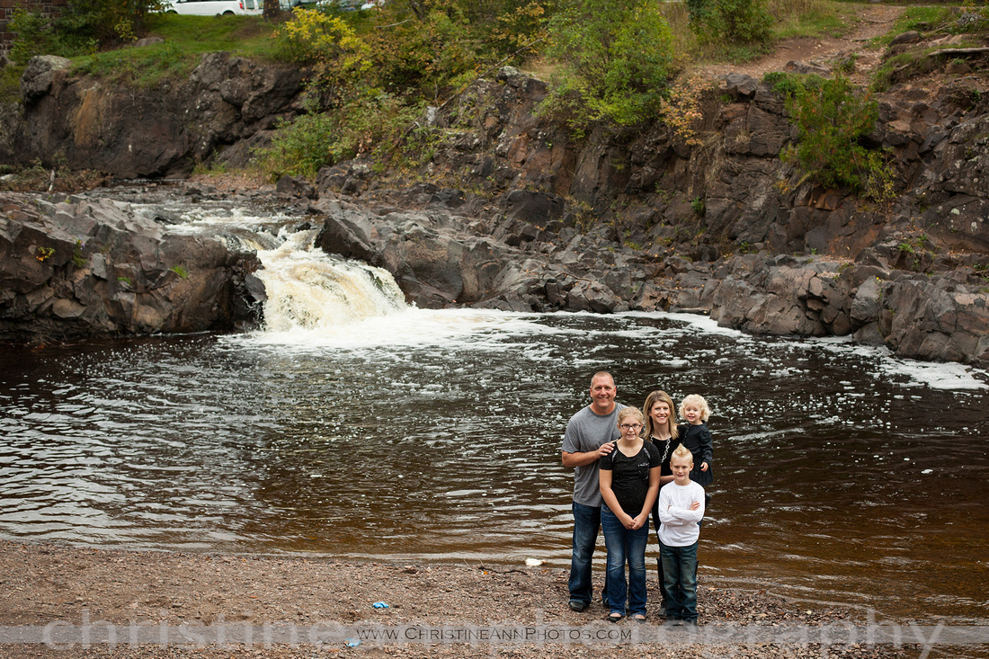 Family photo by waterfall creek at Lester Park in Duluth Minnesota.