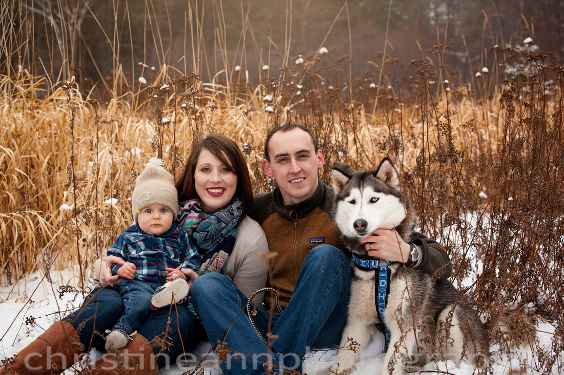 Family winter session at Hartley Nature Center, Duluth MN with husky dog.