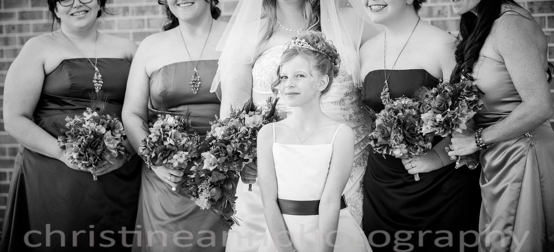 Flower girl with bridesmaids.
