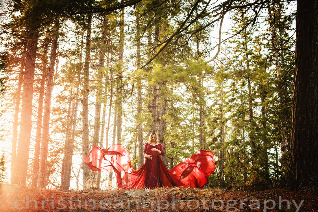 Duluth MN Lester Park Couples Maternity Photoshoot Amazon lace dress and throwing train sheer gown