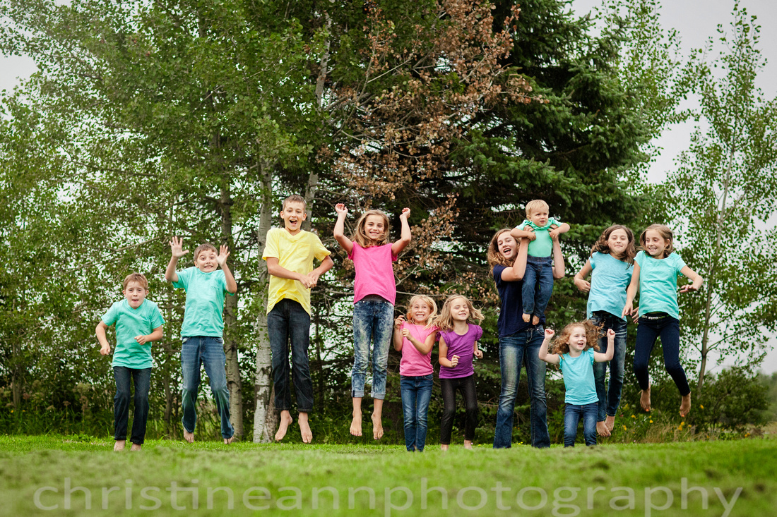 Fun jumping photo with big group of young kids