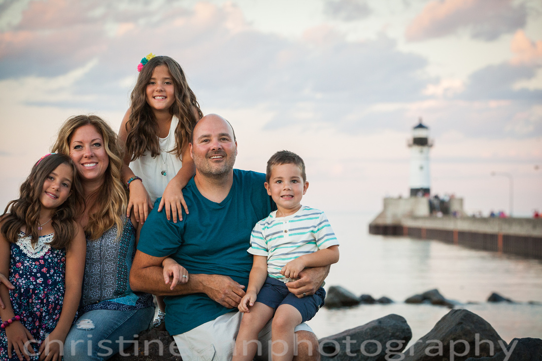 North Pier Lighthouse Aerial Lift Bridge Duluth MN Family Photographer North Shore Photoshoot with twin girls
